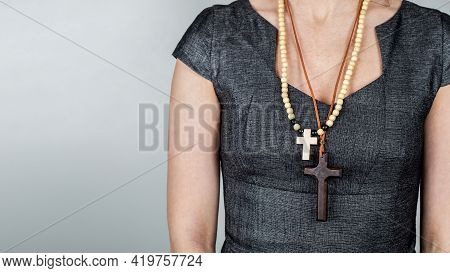 Woman With Wooden Crosses Around Her Neck. Religion And Belief
