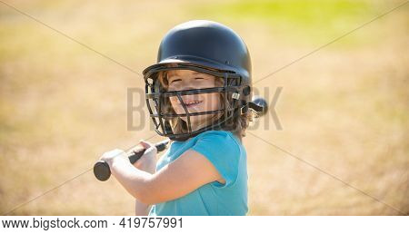 Funny Child Playing Baseball. Batter In Youth League Getting A Hit. Boy Kid Hitting A Baseball.