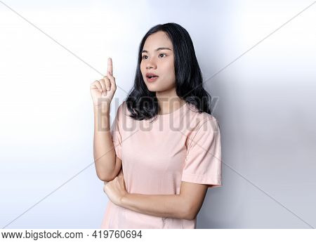 Girl Has An Idea To Solve Problem. Pretty Asian Woman Keeping Finger Pointed Upwards. Young Female R
