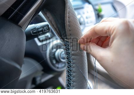 Braided Steering Wheel With Leather Cover. The Mechanic Change A New Cover Of The Steering Wheel Of
