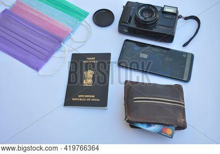 Mandi, Himachal Pradesh, India - 04 24 2021: Overhead View Of Important Accessories Of Travel Isolat
