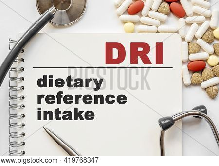 Page In Notebook With Dri On White Background With Stethoscope And Group Of Pill. Medical Concept. T