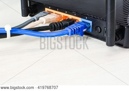 Home Wi-fi Router For Internet Connection With Four Patch Cords And Cable Tie. Concept Home Network,