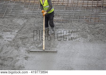 Leveling The Concrete Floor Of The Foundation Formwork