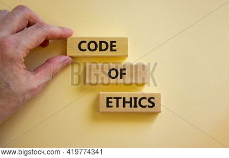 Code Of Ethics Symbol. Wooden Blocks With Words 'code Of Ethics'. Beautiful White Background. Busine