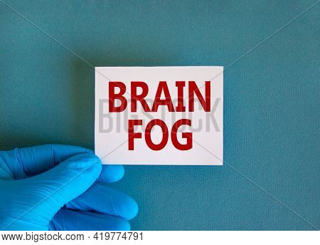 Medical, Covid-19 Pandemic Coronavirus Brain Fog Symbol. Doctor Hand Holds White Card With Words 'br