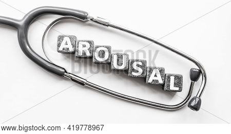 Stone Block Form Word Arousal With Stethoscope. White Background. Medical Concept. State Of Being Aw