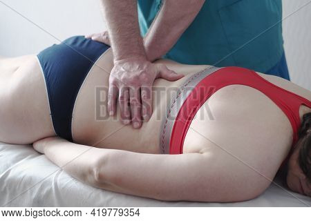Back Massage. The Patient Is A Woman On The Massage Table. Manual Massage, Manual Therapy. High Qual