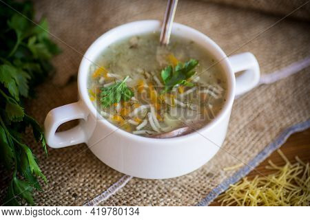 Cooked Hot Soup With Noodles And Vegetables