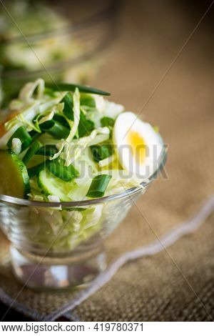 Spring Salad With Early Cabbage, Cucumbers, Eggs And Green Onions