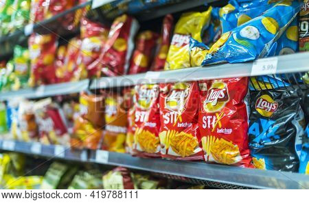 Packets Of Lays Potato Chips In Supermarket