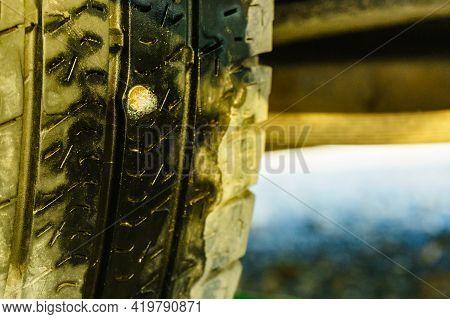 Broken Tire Because Of Nail Pounding, Closeup.