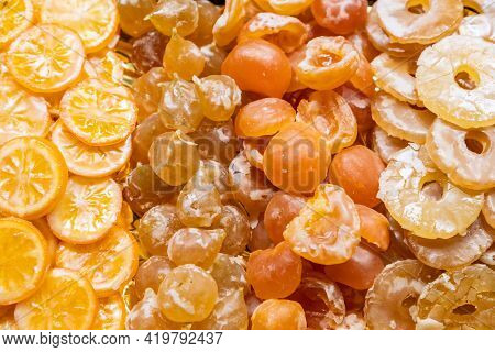 Candied Lemons, Peaches, Plums And Pineapple. Fruit Background (selective Focus)