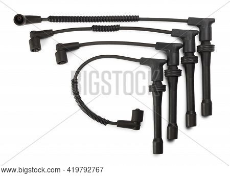 Black Ignition Wires Of A High Voltage For Spark Plugs Isolated On White Background. Car Parts. Top