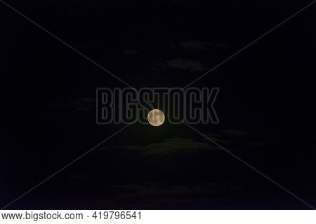 Craters On A Sunlit Bright Moon In A Dark Black Clear Sky At Night In Spring, Almere, Flevoland, The