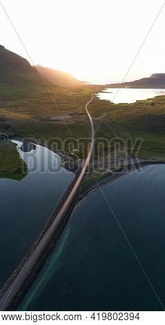 The road along the lake in the morning drone shot