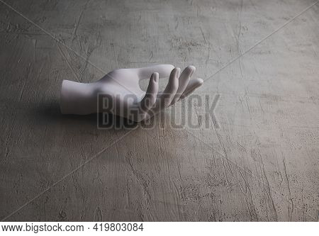 Plastic Hand On A Grey Concrete Surface. Front View. Minimalism. Copy Space
