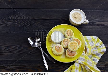 Cheesecakes Syrniki , Curd Fritters With With Sour Cream On Wooden Background, Top View. High Qualit