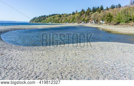 A View Of Waterfront Homes And A Tide Pool In Des Moines, Washington.