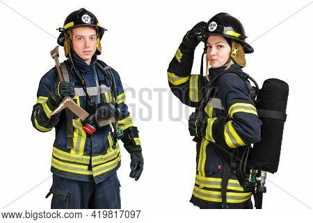 Young Caucasian Man And Woman In Uniform Of Fireman Posing In Profile With Air Cylinder Assembly On