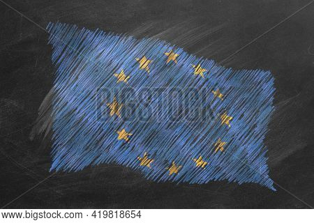 National Flag Of European Union Hand Drawn With Chalk On Blackboard. Flag Waving In Wind. One Of A L