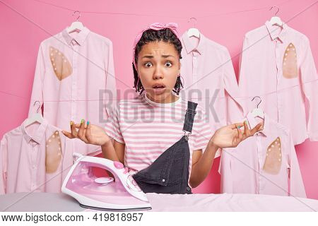 Indignant Puzzled Housewife Spreads Palms Sideways Feels Hesitant Poses Near Ironing Board Doesnt Kn