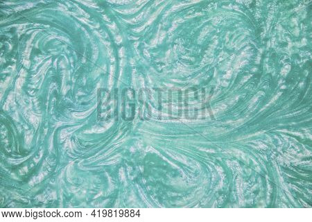 Liquid Turquoise Epoxy Resin Top View. Background