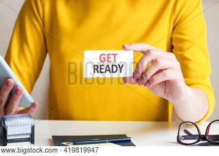 Businesswoman Holding A Card With Text Get Ready, Concept
