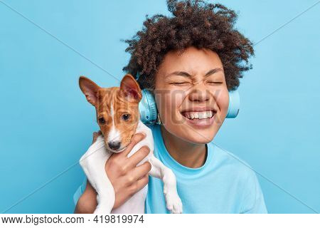 Happy Curly Haired Teenage Girl Plays With Pedigree Dog Enjoys Company Of Favorite Dog Have Walk Tog