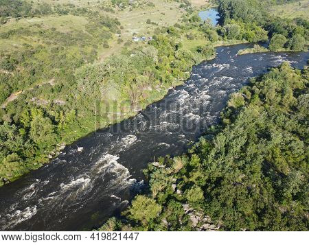 Picturesque River Rapids On The Southern Bug. Rapid Flow Of The River Over Rocky Terrain, Landscape