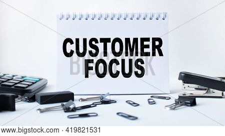 Notepad With Text Customer Focus On The Office Desk With Stationery. A Blank Notepad For Entering A