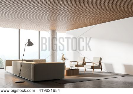 Interior Of Modern Living Room With Wooden Ceiling, Furniture, Table And Armchairs, Big Couch In The
