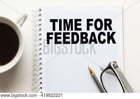 Notepad With Text Time For Feedback On The Office Desk With Stationery. A Blank Notepad For Entering