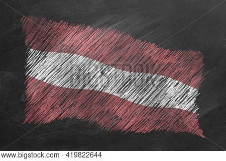 National Flag Of Latvia Hand Drawn With Chalk On Blackboard. Flag Waving In Wind. One Of A Large Ser