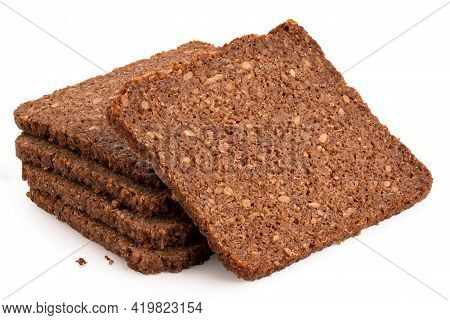 Slice Of German Health Bread With Sunflower Seeds Leaning Against A Stack Of Slices Of German Health