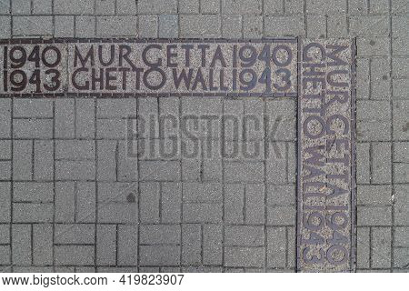 Warsaw/poland, May 3, 2021: Ghetto Wall - A Commemorative Symbol Embedded In The Pavement