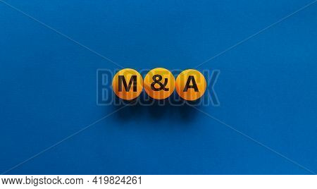 Mergers And Acquisitions Symbol. Concept Word 'm And A, Mergers And Acquisitions' On Orange Table Te