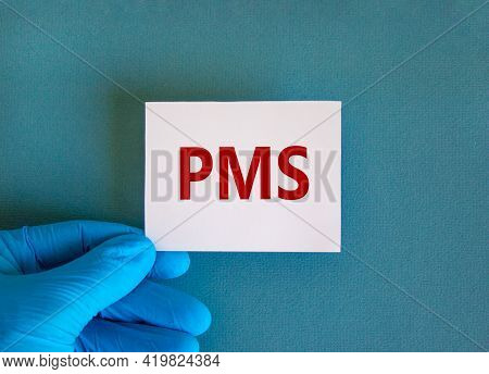 Medical And Pms, Premenstrual Syndrome Symbol. White Card With The Word 'pms'. Beautiful Blue Backgr