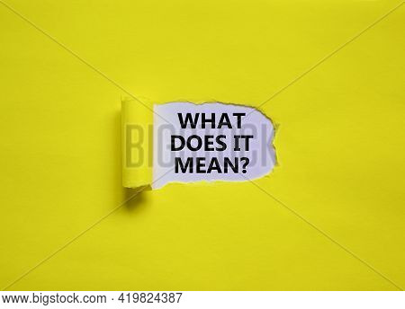 What Does It Mean Symbol. Concept Words 'what Does It Mean' Appearing Behind Torn Yellow Paper. Beau