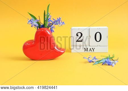 Calendar For May 20 : A Bouquet In A Heart-shaped Vase With Blue Flowers And The Number 20 On Cubes,