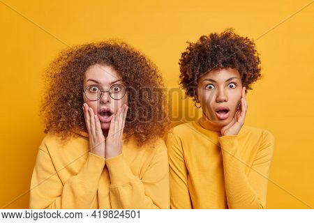 Horizontal Shot Of Shocked Startled Mixed Race Women Open Mouthes From Great Surprisement Find Out S