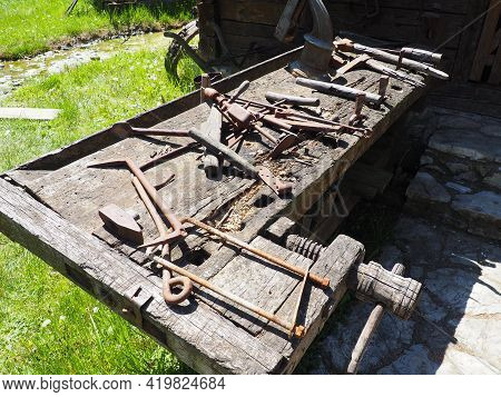 Vintage Working Tools On A Wooden Table. Wooden And Metal Tools For Building And Rural Life. Hammer,