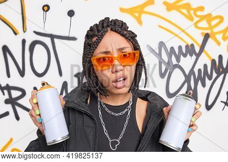 Discontent Indignant Teenage Girl With Dreadlocks Smirks Face Holds Aerosol Spray Doesnt Like Someth