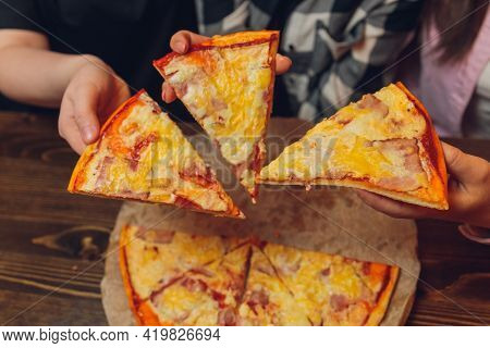 Close Up Female Hand Holding, Taking Slice, Piece Of Pizza Friends Sitting Together In Cafe, Spendin