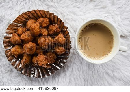 Tasty Rice Bhajiya Or Pakoda Also Known As Rice Ball Fritters Is Made Out Of Leftover Rice, Gram Flo