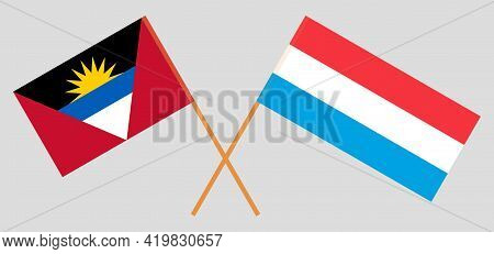 Crossed Flags Of Antigua And Barbuda And Luxembourg
