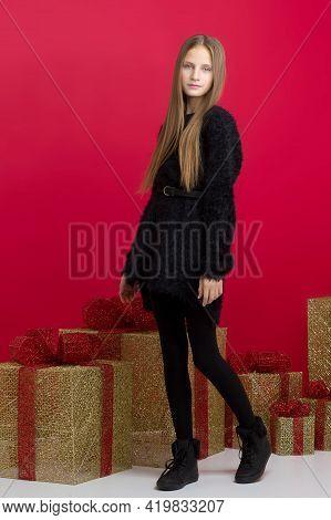 Smiling Teenage Girl In Black Dress. Full Length Portrait Of Pretty Girl Wearing Black Stylish Outfi
