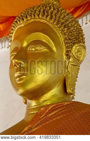 Closeup Of Golden Statute Of Buddha Head In Monastry Luang Prabang, Laos.