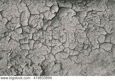 Background Of Dry Cracked Soil Dirt Or Earth During Drought. Dry Cracked Earth Depicting Severe Drou