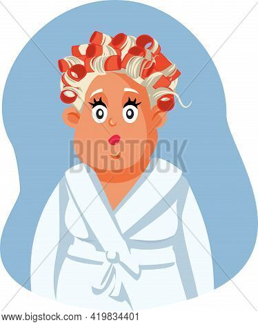Middle Aged Woman Wearing Hair Rollers And Bathrobe